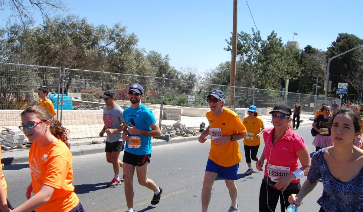 Steve Zerobnick and his son running the Jerusalem Marathon